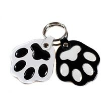 Black and white dog paw key rings