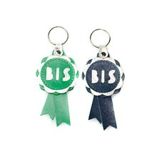 Show rosette key rings in navy blue and emerald green
