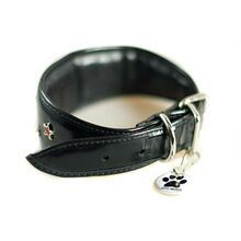 Full leather lining and padding on black patent leather hound collar with red crystal stars