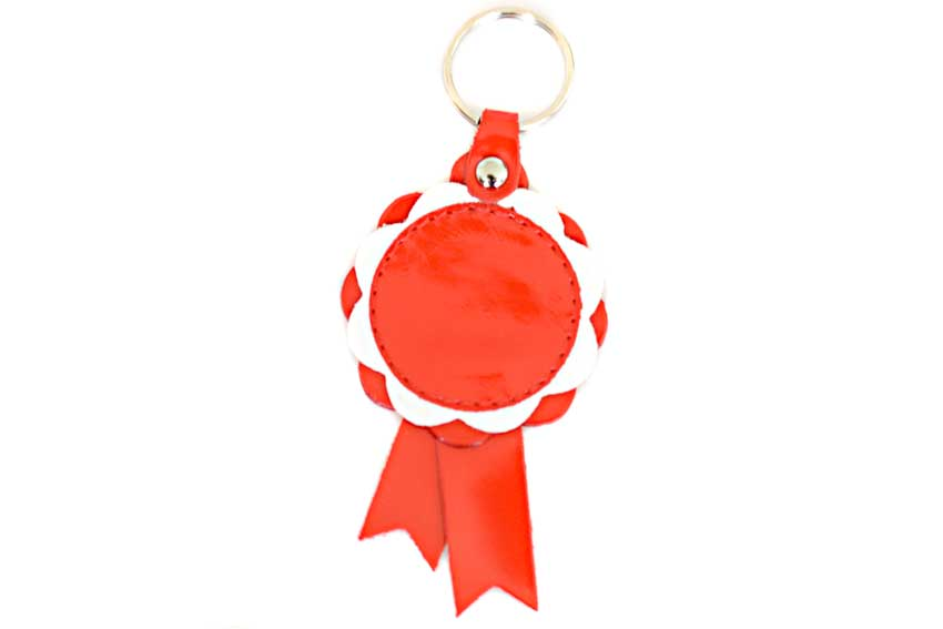 Red leather Winner show rosettes can be customised with your personal message