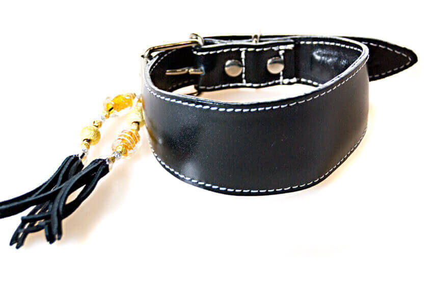 Dress up your traditional handmade black leather hound collar with a striking tassel