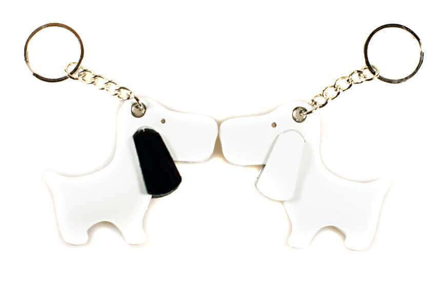 Dog Moda leather key rings in white and white with black patent leather