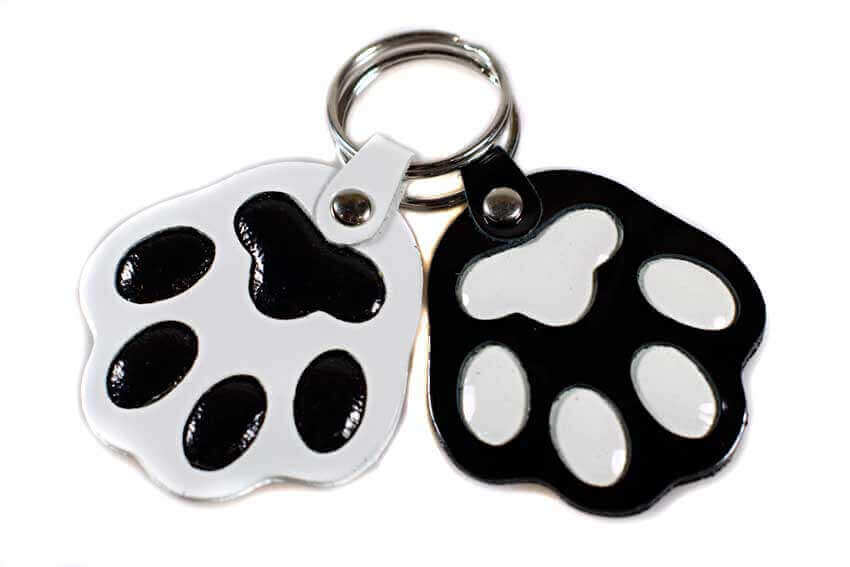 Black and white dog paw key rings