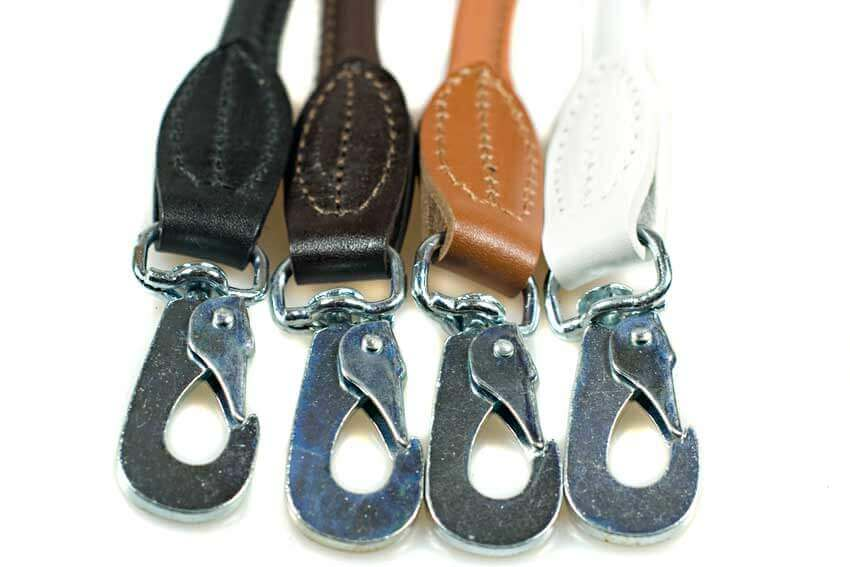 Rolled leather dog leads are available in black, brown, tan, white and red colours
