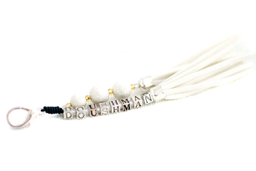 Personalised white tassel with letter beads