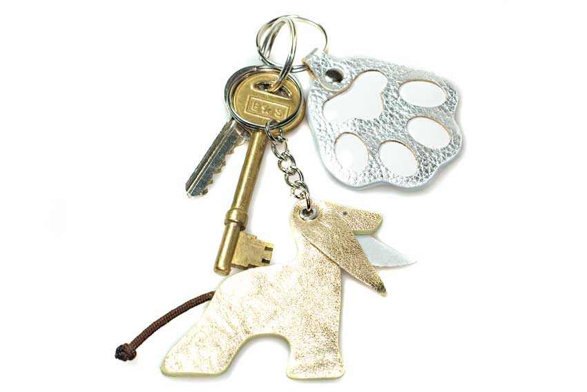Gold Afghan hound key ring with a silver dog paw