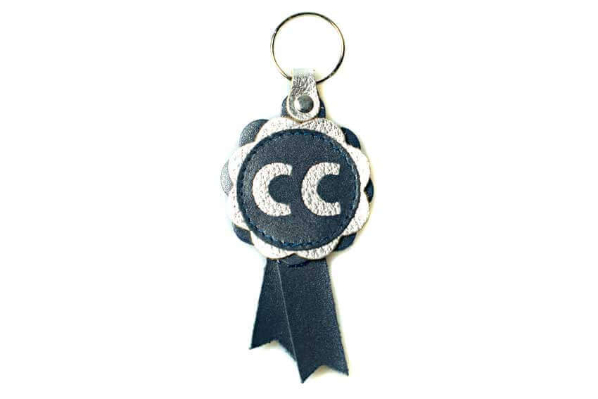 Blue and silver leather CC winner rosette key fob
