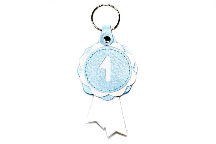 Winner show rosette key ring in baby blue