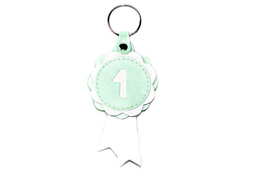 Winner show rosette key ring in pale green