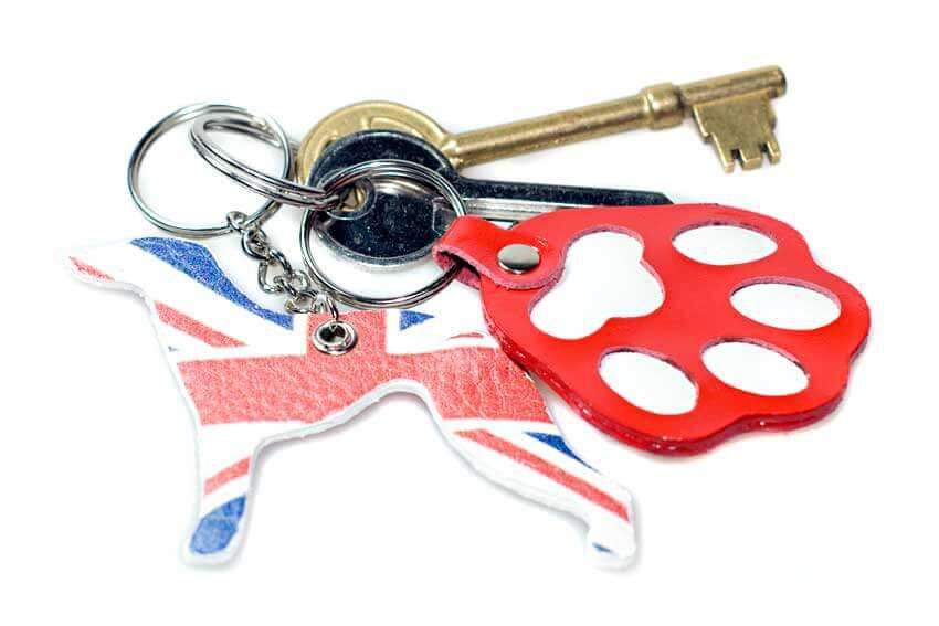 British greyhound with red paw key fobs