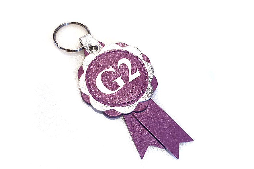Lilac / Silver agility grades leather rosette. Celebrate winning into agility grade 2 with our leather rosette keyrings