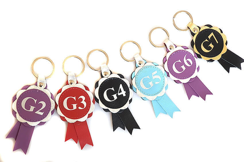 Agility grades leather rosette keyring / bag charms. Available in all colours for all grades: G2, G3, G4, G5, G6, G7
