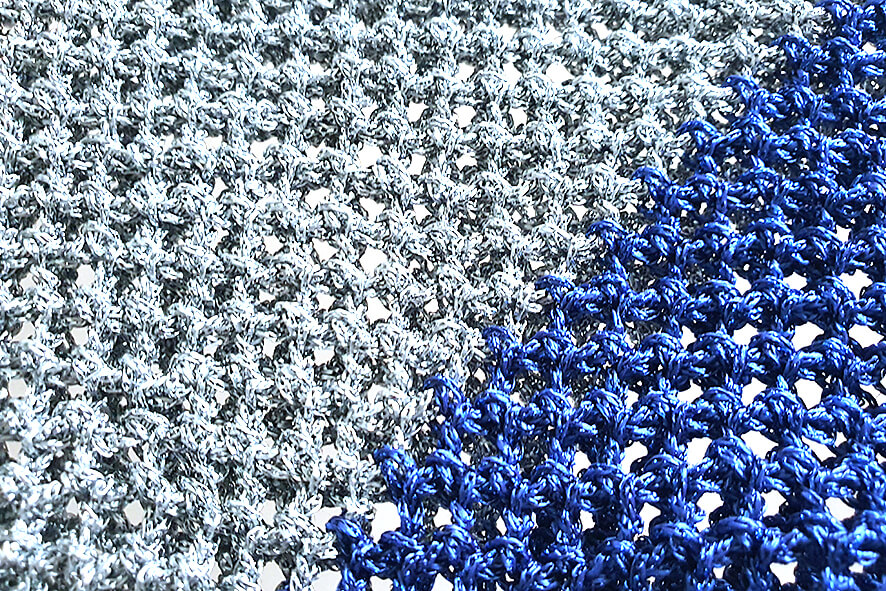 Close up of silver and blue handmade crochet dog snood