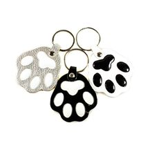 Silver, black and white dog paw key rings