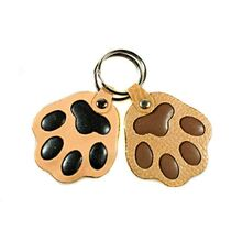 Beige and brown leather dog paw key rings