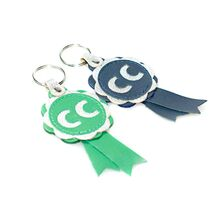 CC winner rosette key rings are available in blue and green with silver leather