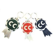 CC rosettes in red, green and blue with silver
