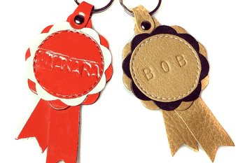 Winner show rosettes in beige and red can be customised with your personal message